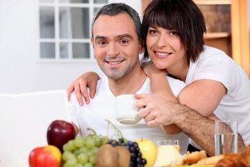 husband and wife having breakfast