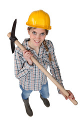 Smiling woman with a pickaxe