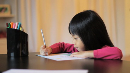Girl Coloring A Pretty Picture