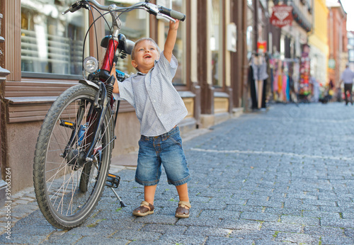 cute little boy with big bike