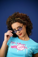 Frizzy haired woman removing sunglasses
