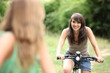 Two teenage girls on bike ride