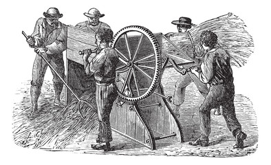 Five people using threshing machine also known as  thrashing mac