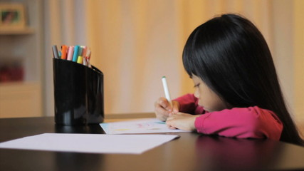 Little Girl Coloring With A Felt Marker
