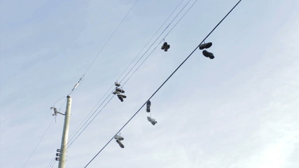 Running Shoes Hanging From Hydro Wires