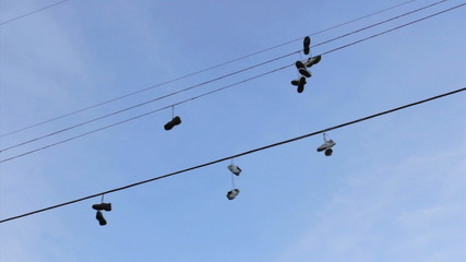Running Shoes Hanging From Telephone Wires