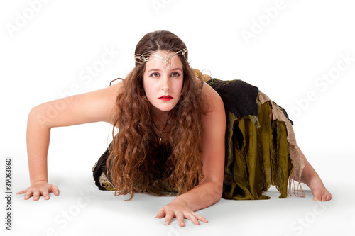 Young dancer crouching in fairy-inspired costume