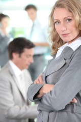 Businesswoman standing arms-crossed