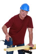 Tradesman using a jigsaw