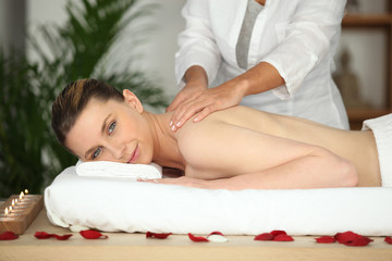 Girl having back massage in beauty parlor