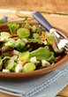 Mix salad with grapes and walnuts with blue cheese