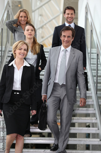 portrait of a business team in stairs