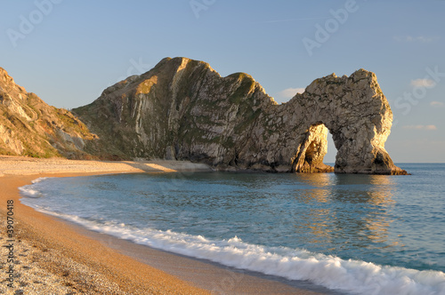 Poster Late evening light at Durdle Door Lulworth Dorset England.
