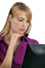 A serious receptionist wearing a headset
