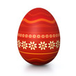 Red painted easter egg with flower pattern