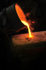 Foundry - molten metal poured from ladle into mould - lost wax