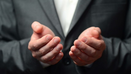 Businessman with cupped hands as if holding something
