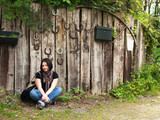 Girl against the background of old wood fence - 39075457