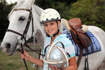 professional female jockey posing with her horse