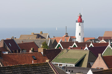 Aerial view at the lighthouse and roofs of a old characteristic