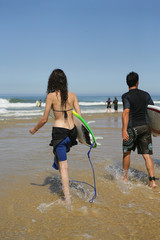 Couple of young surfers