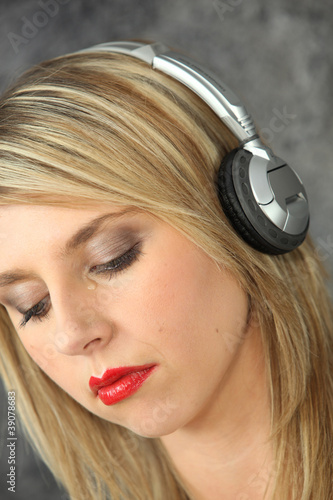 Sad woman listening to music