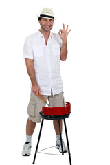young man and his barbecue