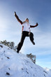 Woman jumping in the snow