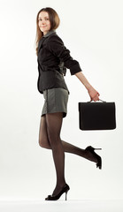 Young brunette (businesswoman or student) holding briefcase