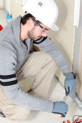 Electrical worker testing socket
