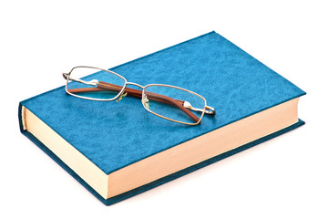 Glasses on the blue book