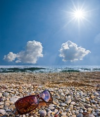 sunglasses on a seashore