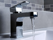 Modern chrome faucet with running water
