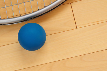 Blue Rubber Racquetball and Racquet