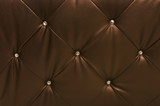 brown leather upholstery with crystals, textured background