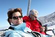 Couple on ski-lift