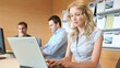 Blond office worker in office with workteam
