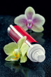 Bottle of face cream/lotion with orchid flowers, closeup shot, o