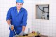 Plumber cutting plastic pipe