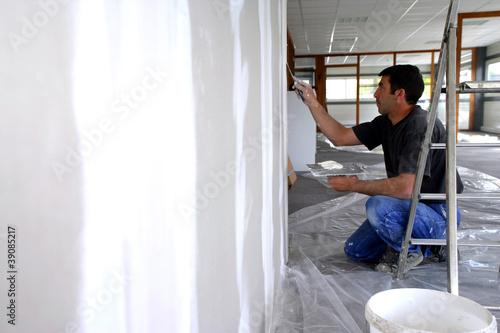 Man plastering a wall