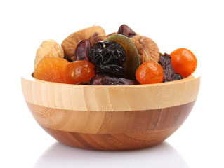 Dried fruits in wooden bowl isolated on white