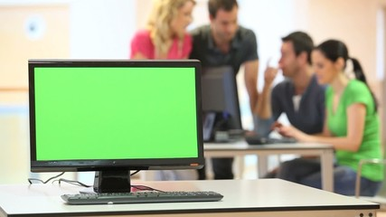 Green desktop screen set in front of workgroup
