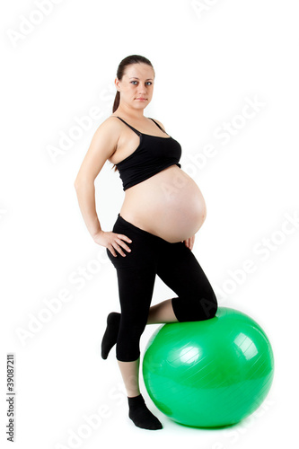 Pregnant woman excercises with gymnastic ball. Beautiful pregnan