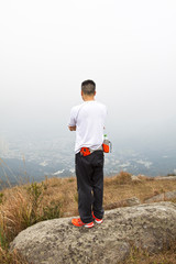 Asian man hiking in mountains