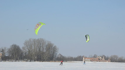 snow kiting sport on the winter lake ice