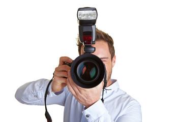 Paparazzo mit Kamera und Blitz
