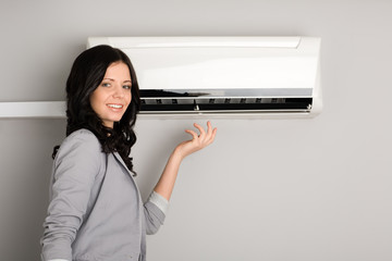 girl showing the air conditioner