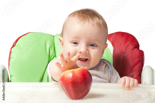 Small baby with apples