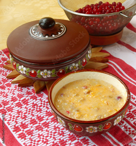 Corn porridge (banush) with a cranberry