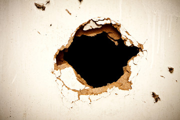 Hole in the fibreboard
